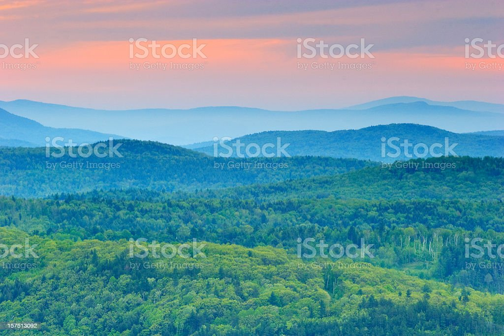 Background of green rolling mountains of Vermont at sunset stock photo
