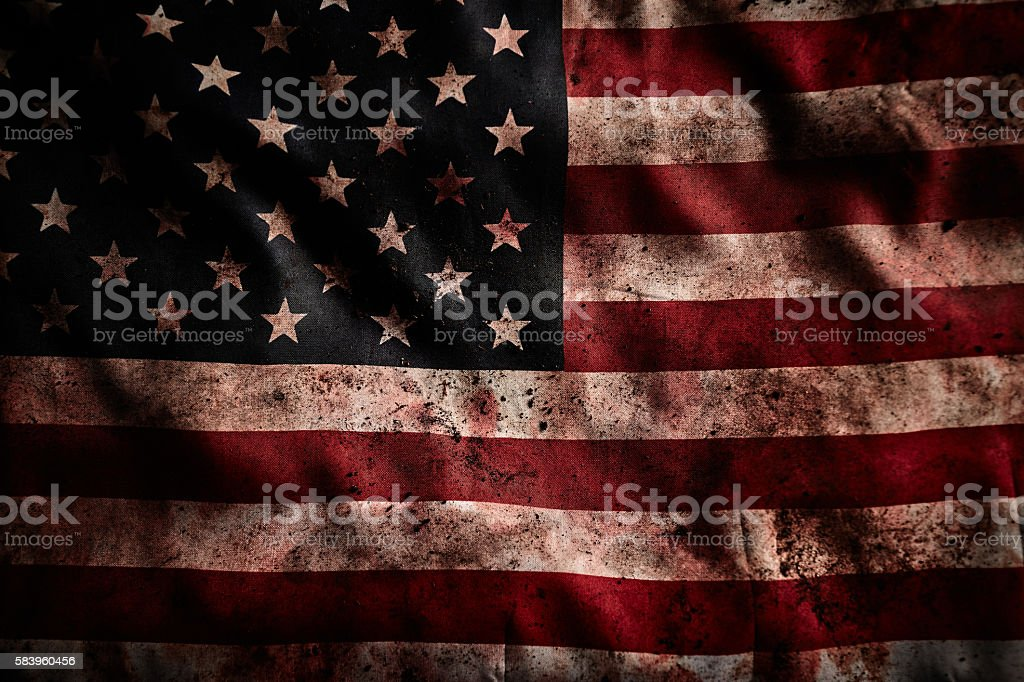 Background of grunge american flag with dirt and blood stock photo
