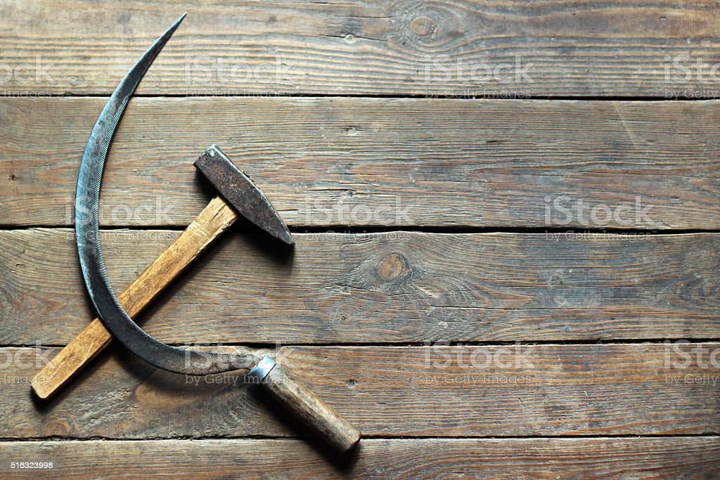 Background of hammer and sickle on old wooden floor stock photo