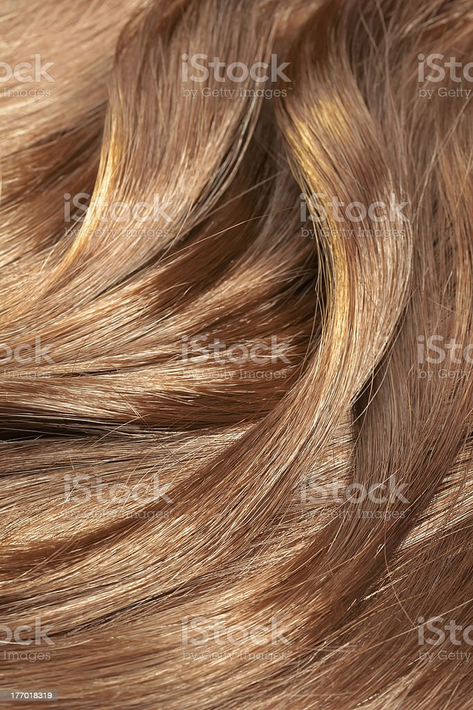 Background of healthy, shiny light brown hair texture royalty-free stock photo