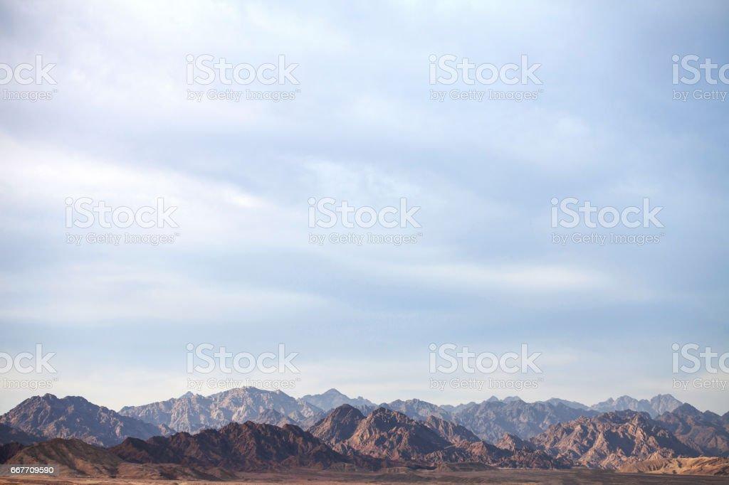 Background of high mountains on the horizon stock photo