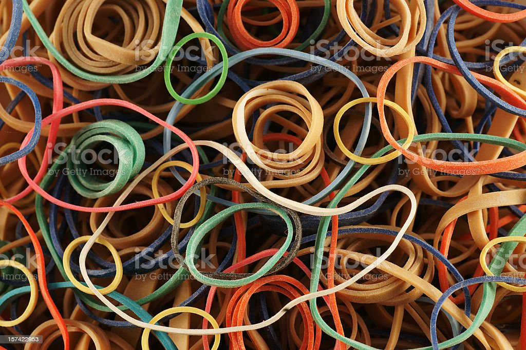 Background of many colored rubber bands stock photo