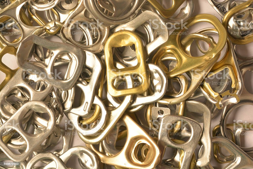 Background of many ring pull can opener, silver and gold. stock photo