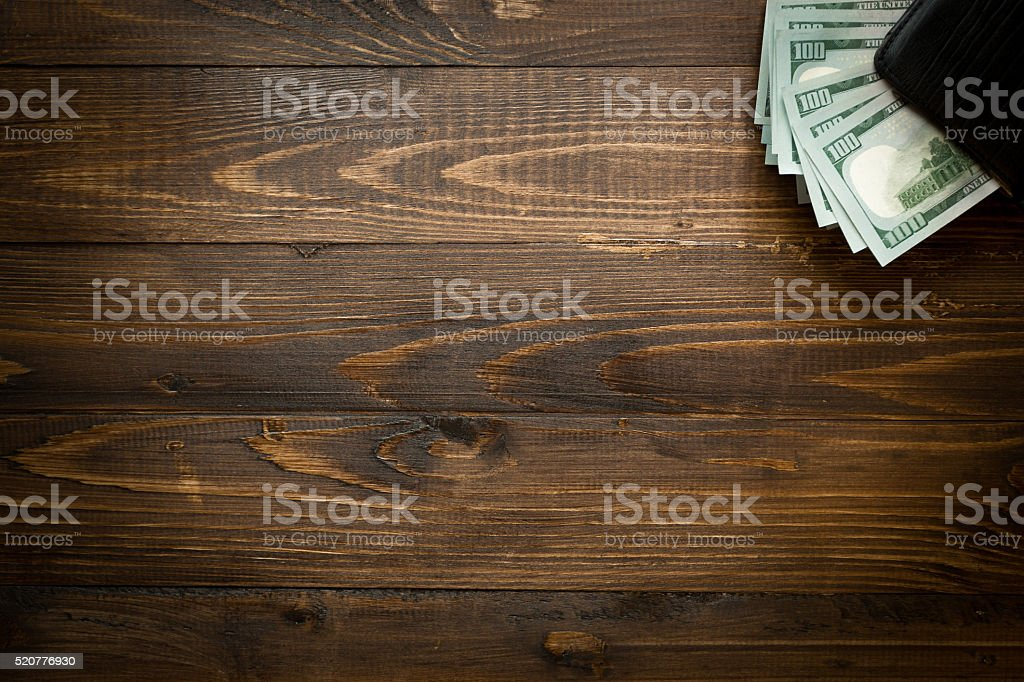 Background of money in purse on wood with copyspace stock photo