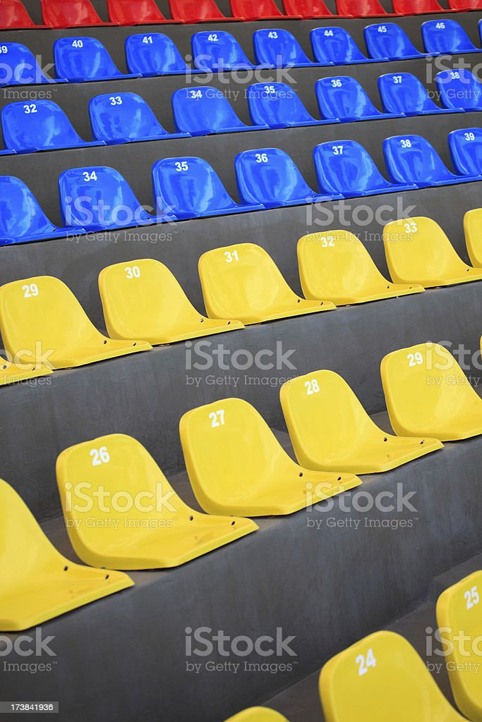 background of multi-colored stools stock photo