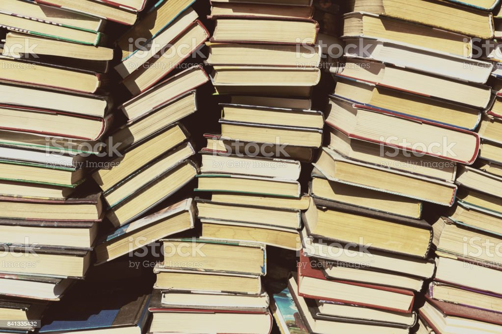 Background of old books located in the bookstore stock photo