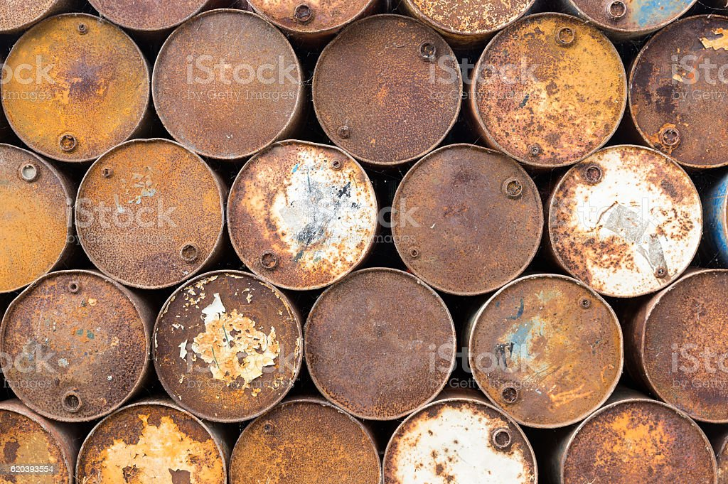 Background of old rusty oil barrels stock photo