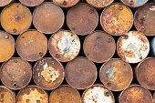Background of old rusty oil barrels
