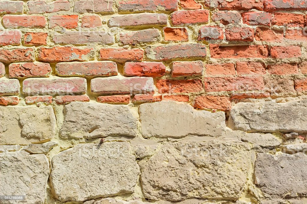 Background of old stone and brick fortress wall stock photo