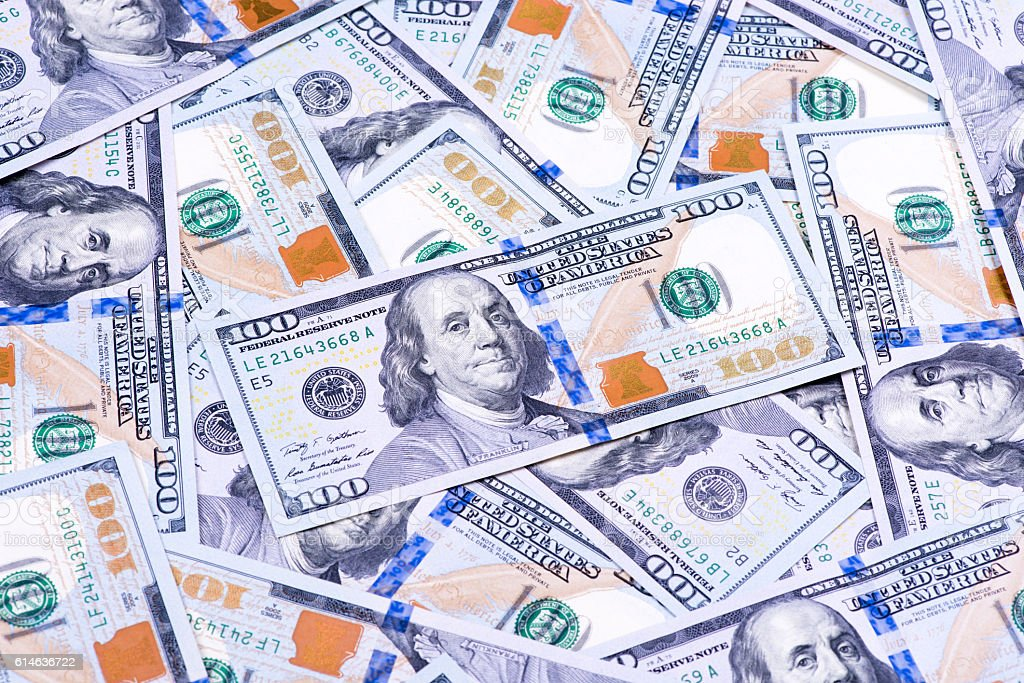 Background of one hundred dollars banknotes stock photo