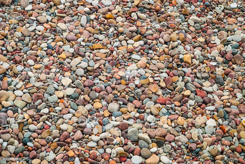 Background of pebble stones on beach, texture stock photo