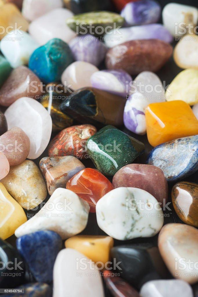 Background of polished colored gemstones stock photo