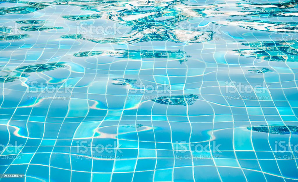 Background of rippled water in swimming pool stock photo