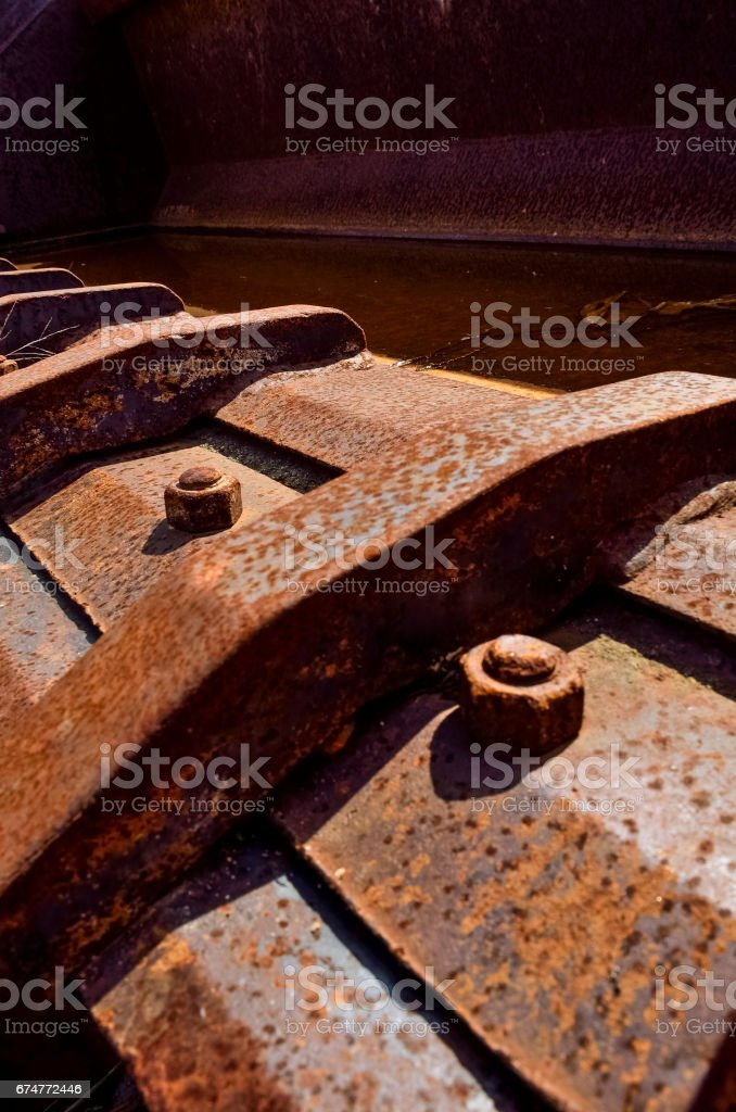 Background of rusty bolts and objects macro closeup stock photo