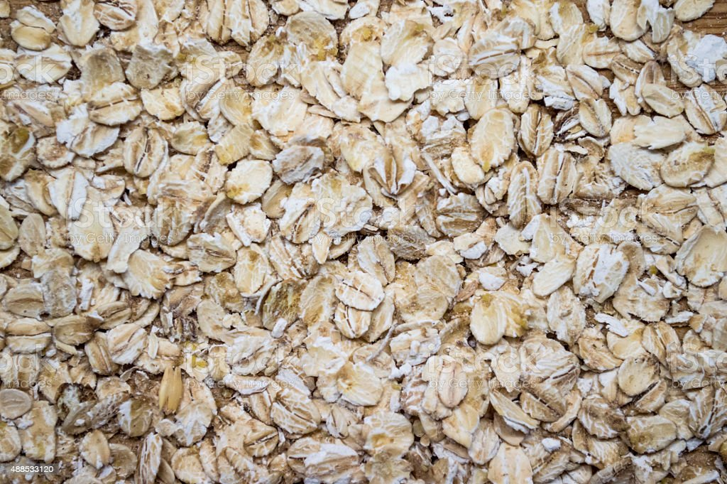 Background of Scattered Traditional Jumbo Rolled Oats royalty-free stock photo