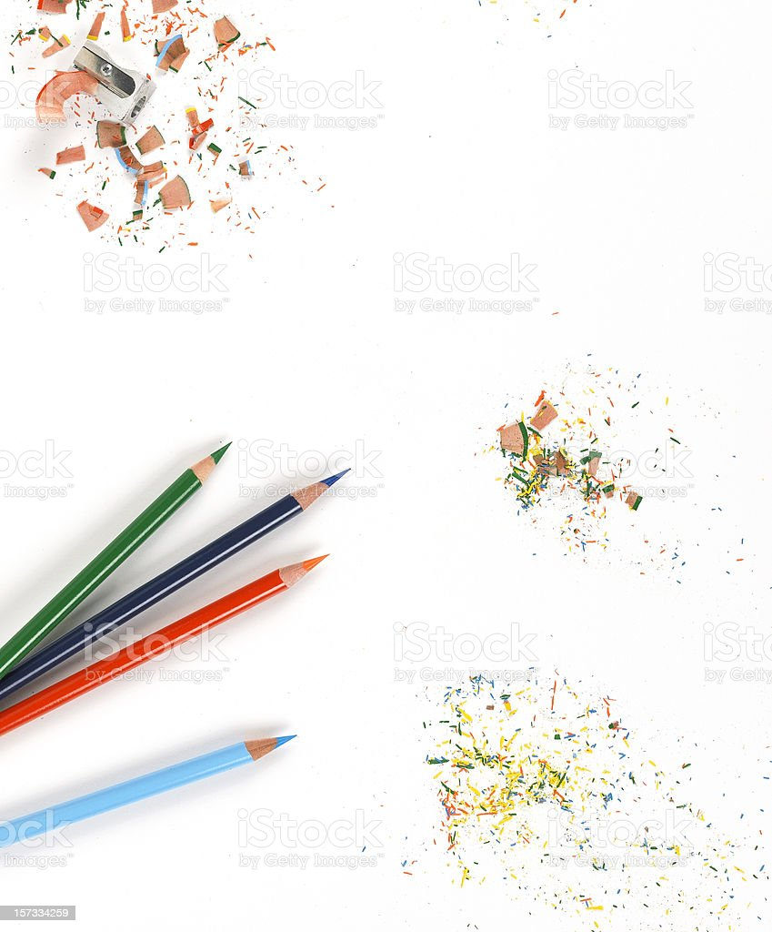Background of Sharp colored pencils and shavings on white stock photo