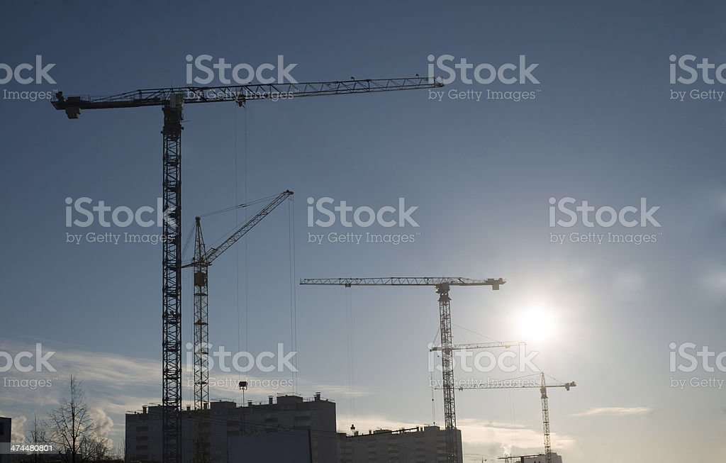 Background of  silhouette building crane lift loads with sun set royalty-free stock photo
