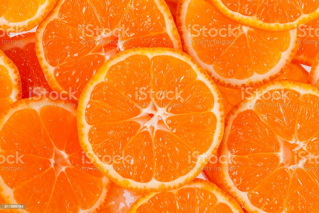 background of slices of clementine fruit stock photo