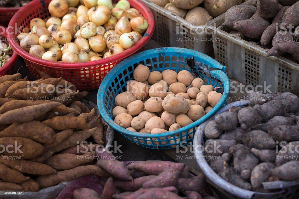 Background of sweet potato, potato, ginger, onion and others stock photo