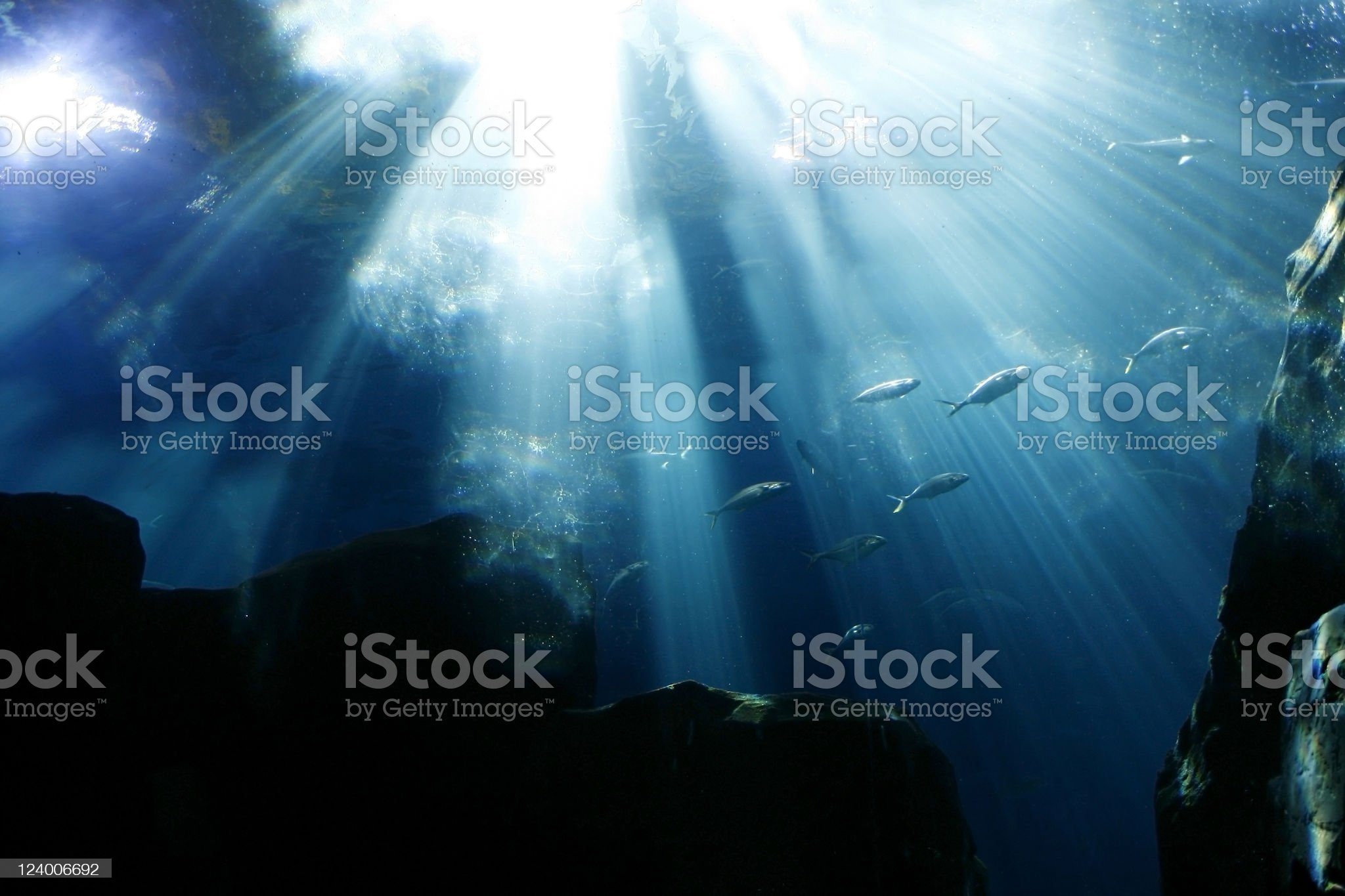 A background of the deep ocean with sun rays shining through royalty-free stock photo
