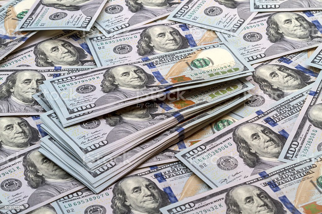 Background of the new banknotes hundred dollars stock photo