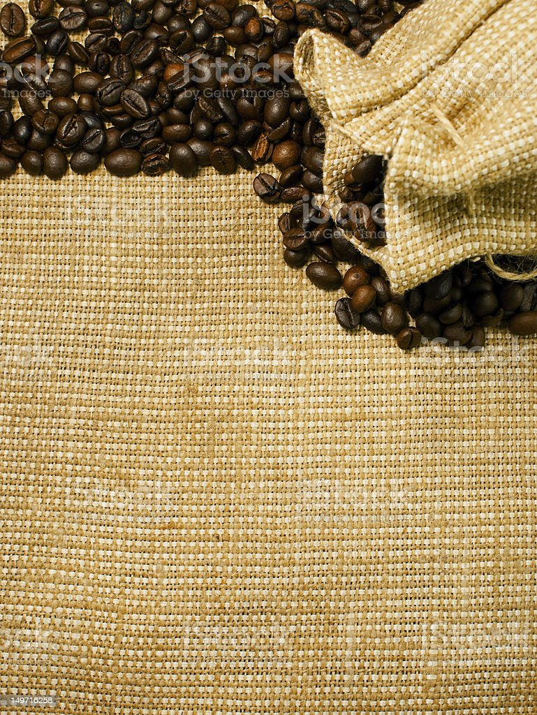 Background of the roasted coffee beans and burlap royalty-free stock photo