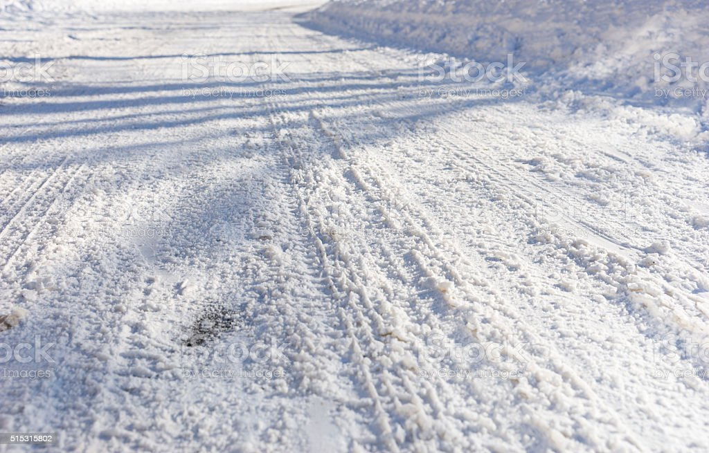 Background of tire tracks in snow stock photo