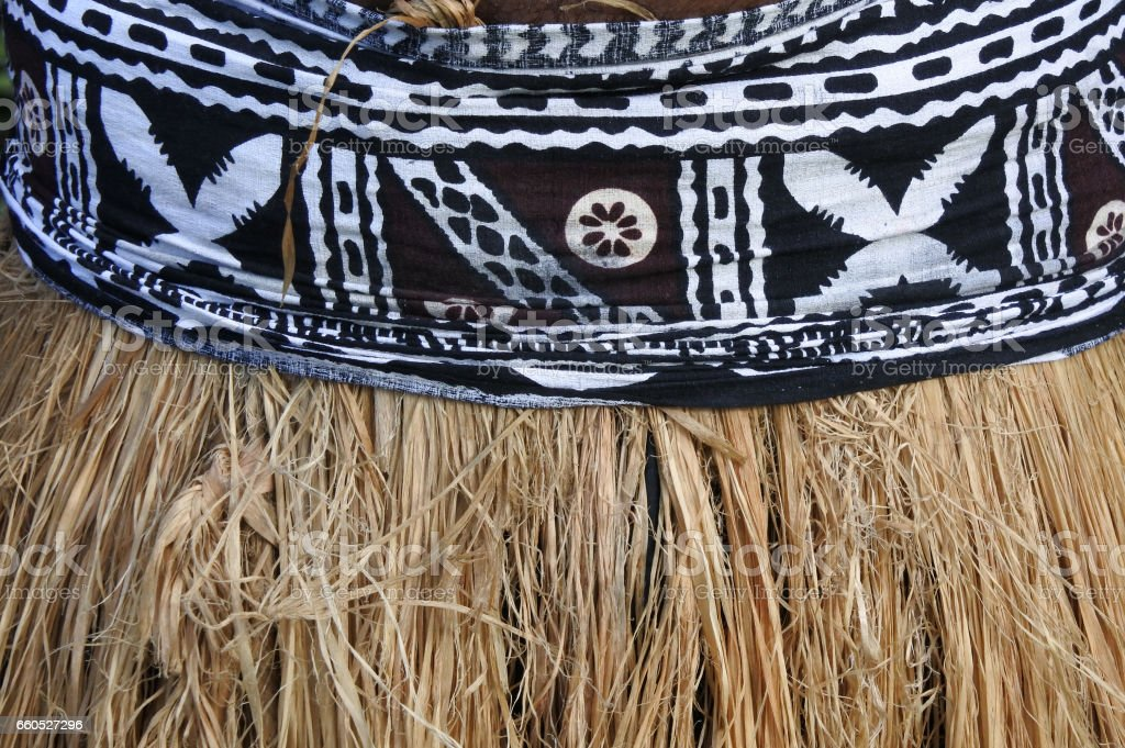 Background of traditional Pacific Island straw skirt and tapa cloth stock photo