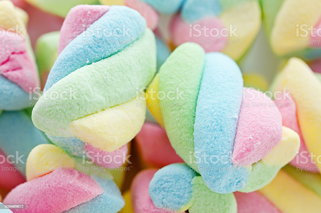 Background of twisted, colorful marshmallow, close up, macro stock photo