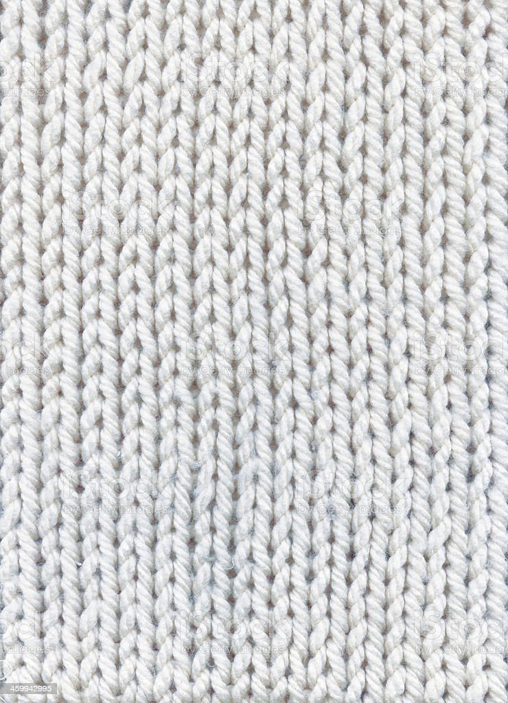 A background of weaving made with white wool  stock photo