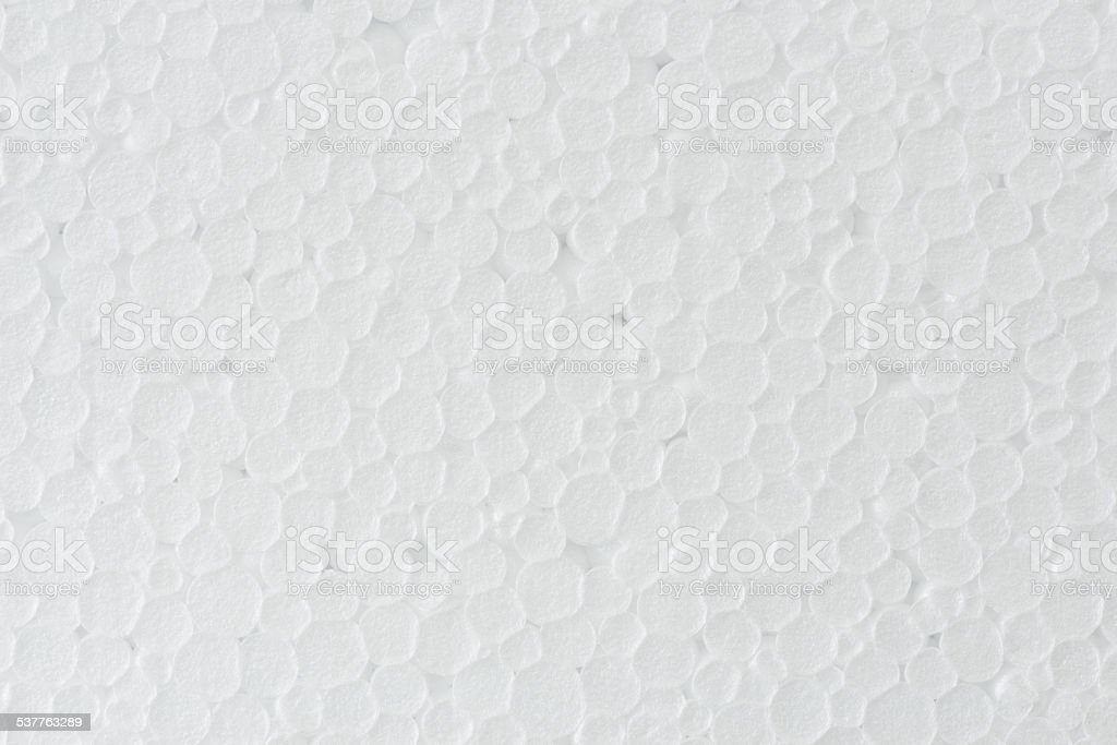 background of white foamed polystyrene surface stock photo