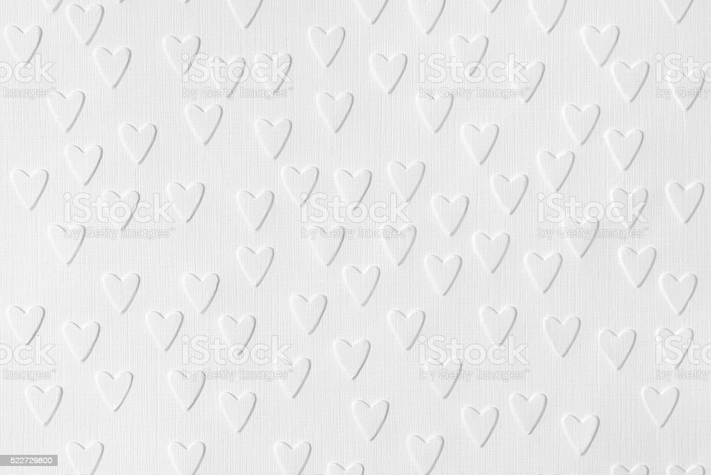 Background of white paper with embossed hearts stock photo