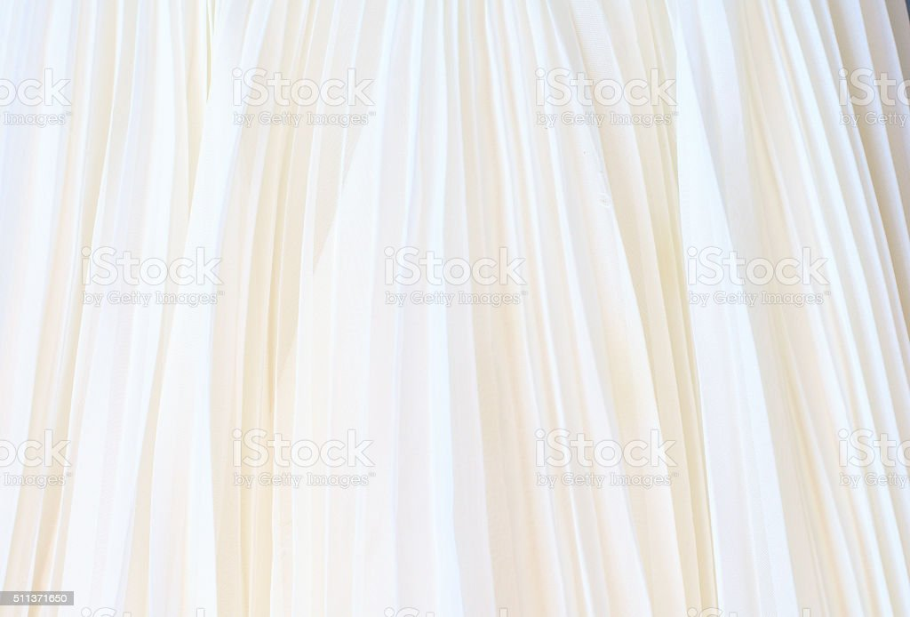 Background of white pleated fabric stock photo