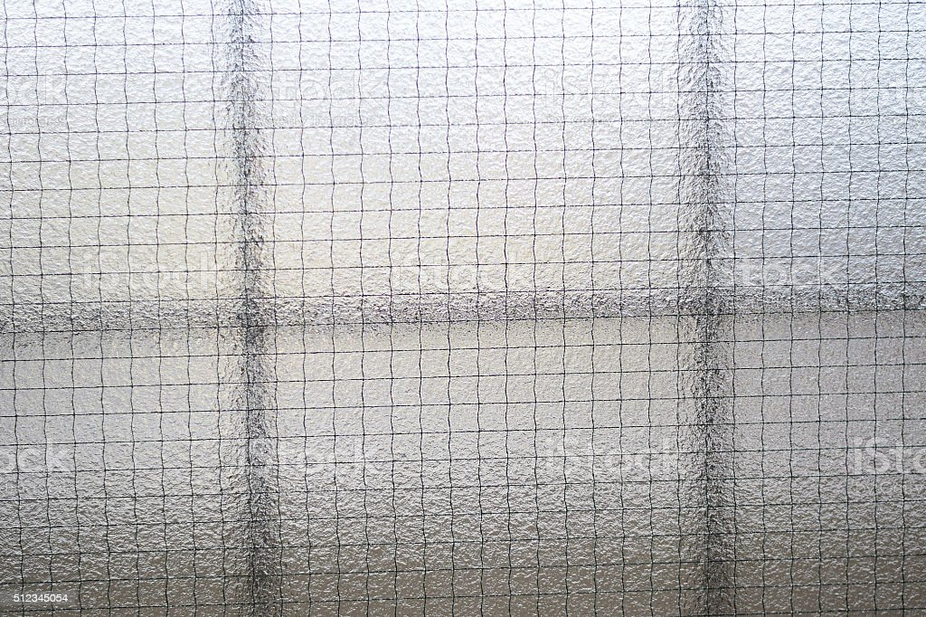 Background of wired window glass stock photo