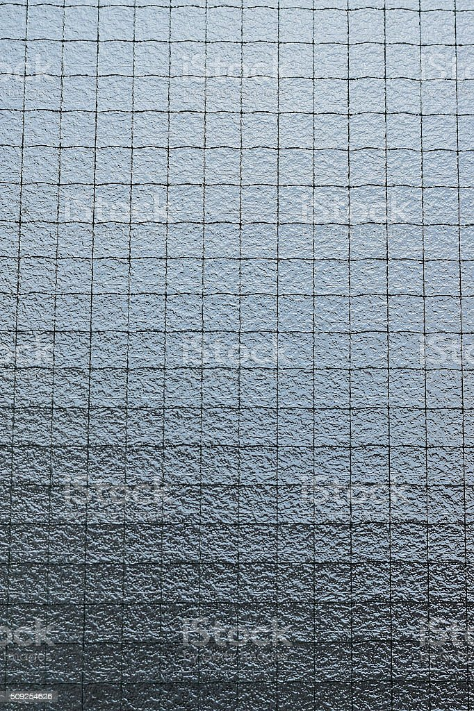Background of wired window glass Vertical frame stock photo