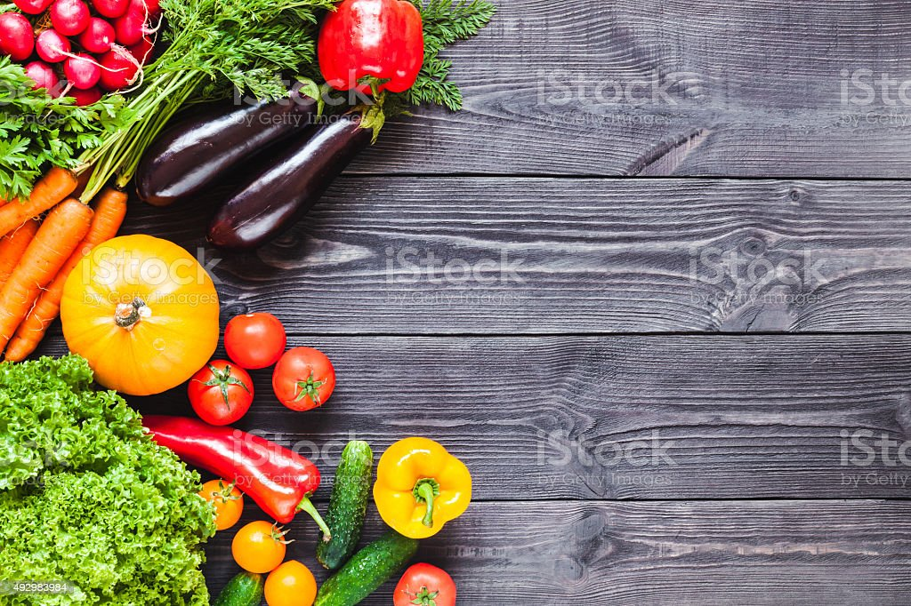 Background of wooden  black planks with fresh vegetables. stock photo