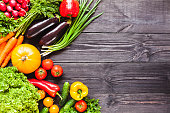 Background of wooden  black planks with fresh vegetables.