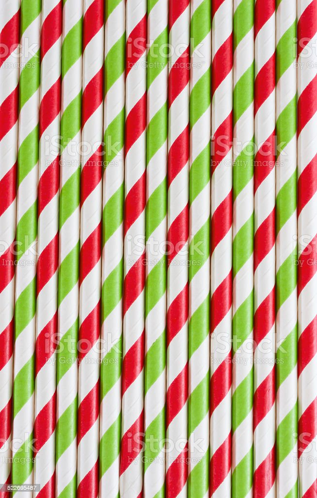 Background or pattern of striped drinking paper straws stock photo