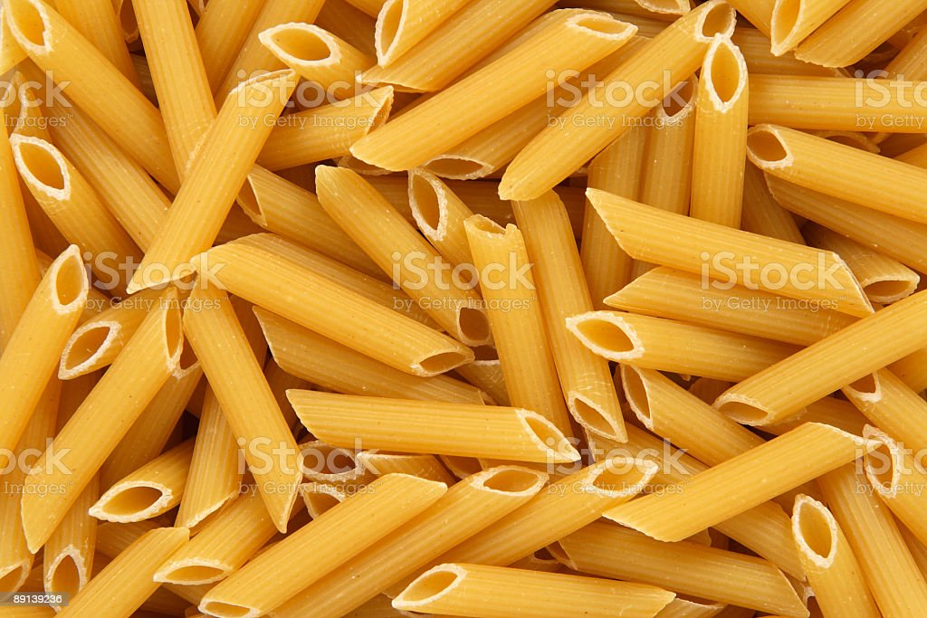 Penne rigate pasta background royalty-free stock photo