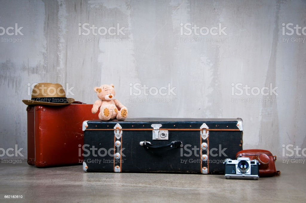 Background stack of old shabby suitcases and the camera stock photo