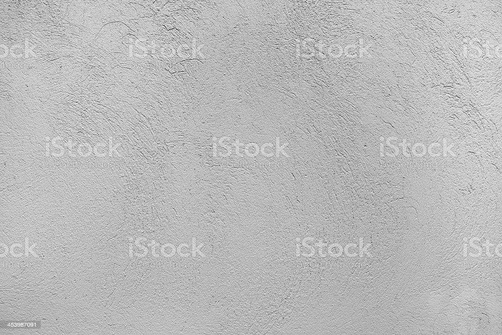 Background texture of a stucco wall in gray stock photo