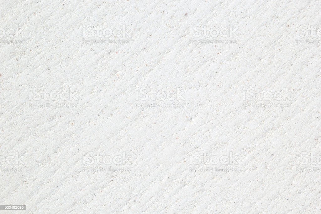 Background texture of a white sand tropical beach stock photo