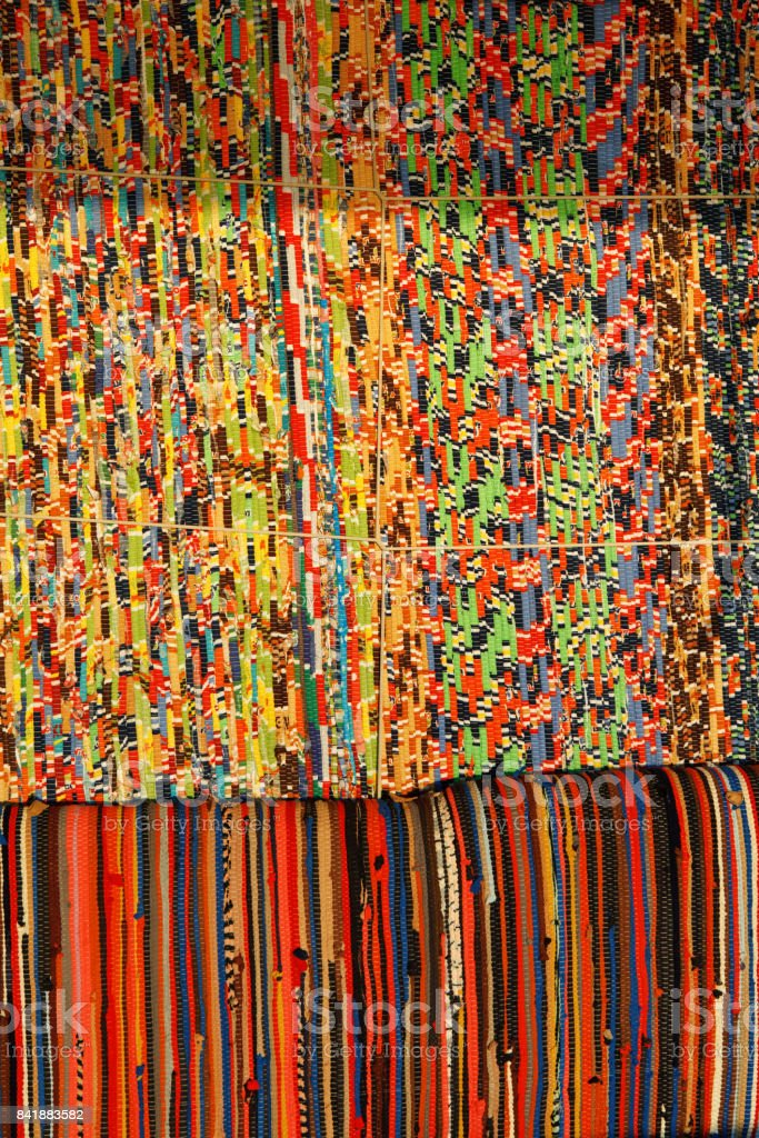 background, texture of colored handmade carpet. Fabric rug of small patches stock photo