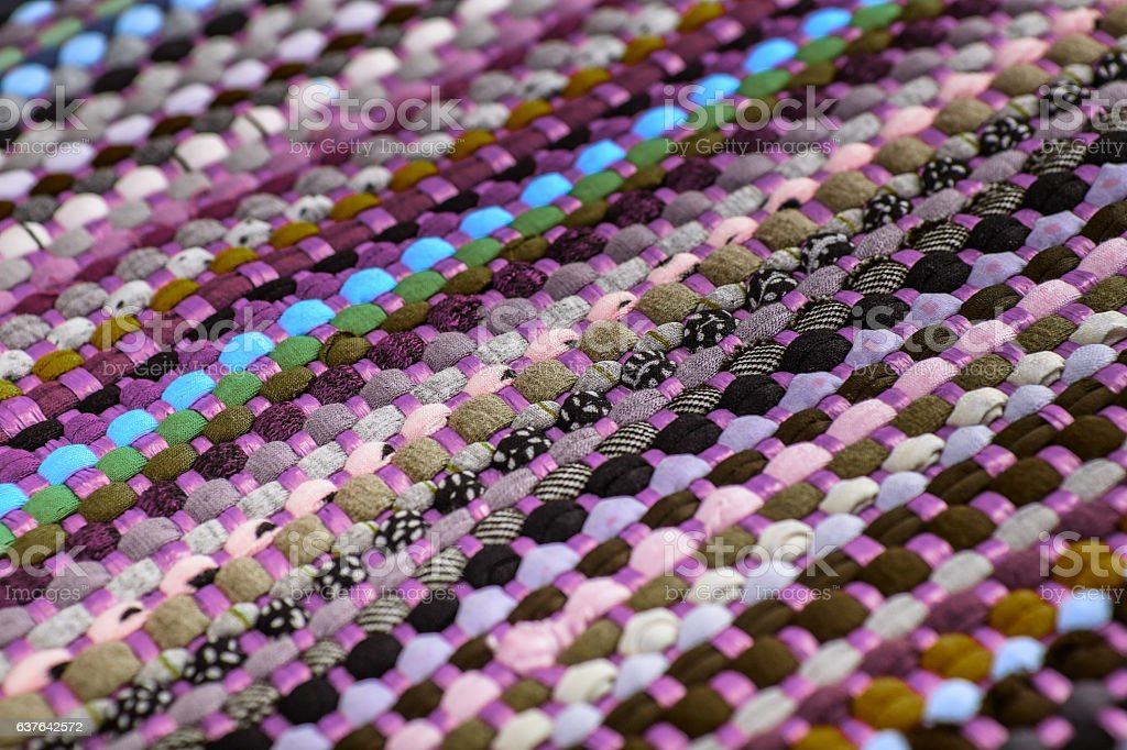 background, texture of colored handmade carpet. stock photo