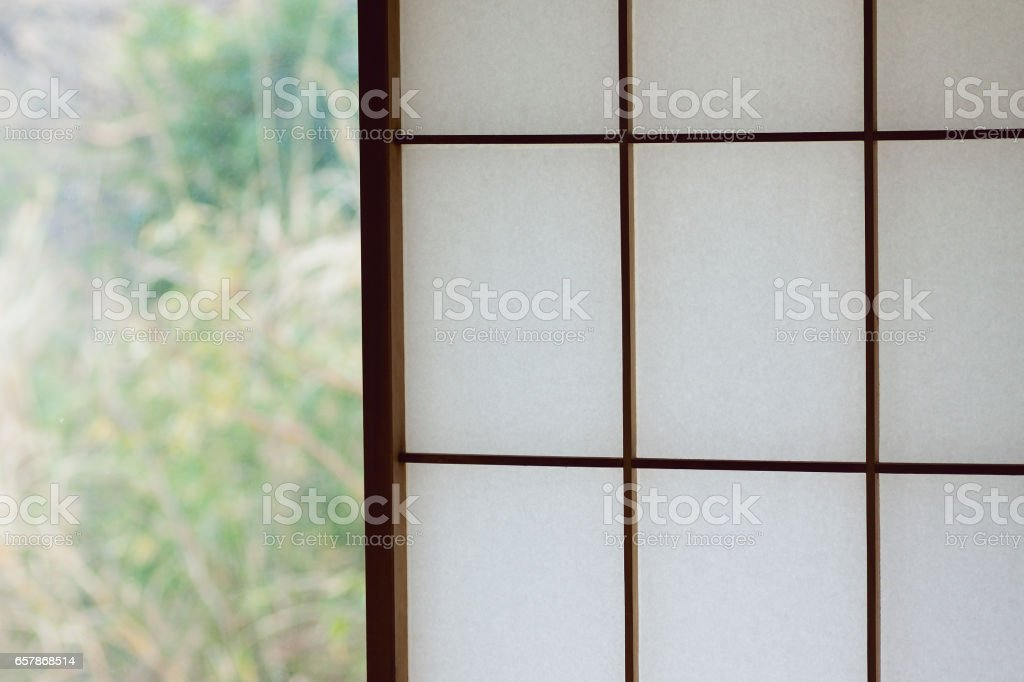 Background texture of Japanese wooden window frame with washi paper stock photo