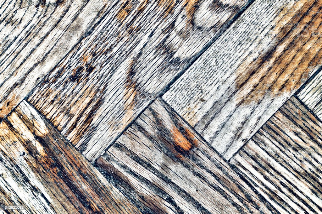 Background texture of old shabby wooden parquet stock photo