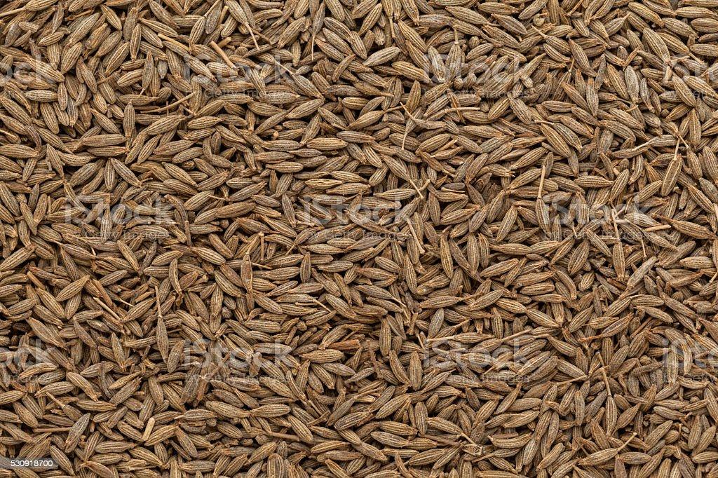 Background texture of Organic Cumin (Cuminum cyminum) seeds. stock photo