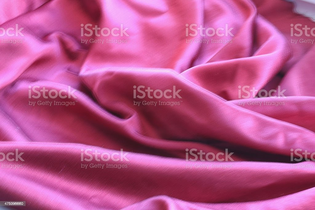 background texture of shiny red silk stock photo