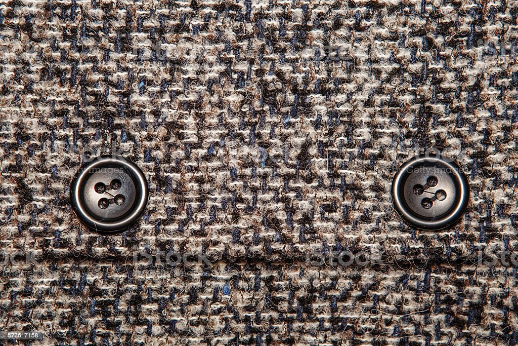 Background texture of twill with two big black buttons stock photo