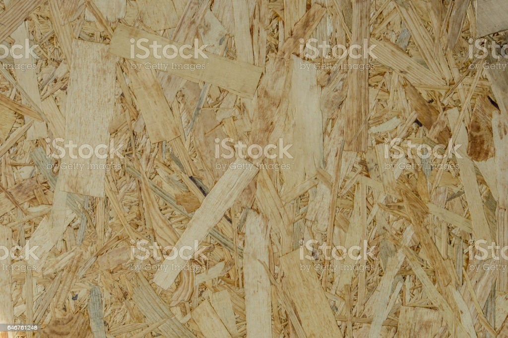 background texture of Wood chips felted brown color (OSB) stock photo
